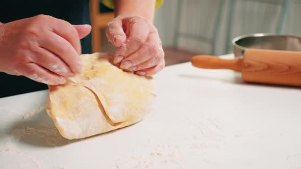 Close Up of Grandmother Hands Kneading