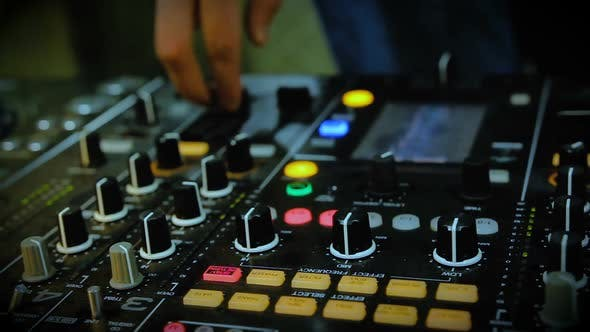 Cover Image for Nightclub DJ Adjusting Controls, Twisting Toggle on Professional Soundboard
