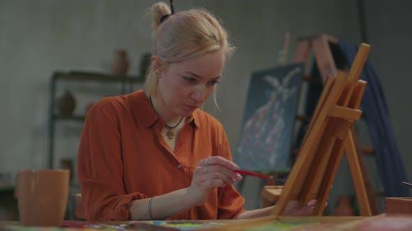 Portrait of Creative Woman Painter Working in Art Studio