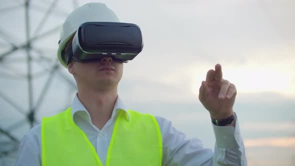 Thumbnail for High-voltage Power Lines Controlled By a Male Engineer Using Virtual Reality To Control Power