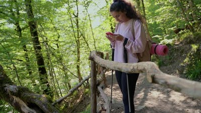 Woman Hiker Using Phone in the Forest