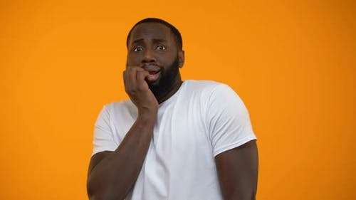 Ridiculous African-American Man Feeling Fear Isolated on Yellow Background