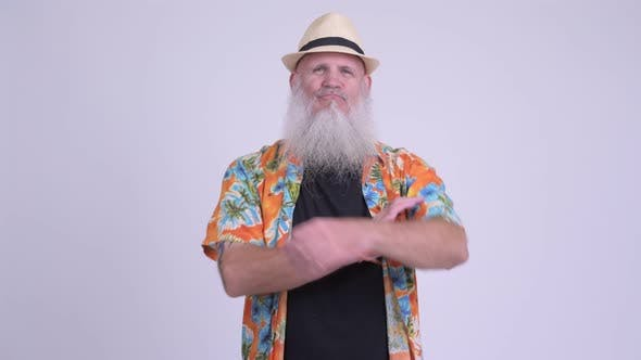 Thumbnail for Happy Mature Bearded Tourist Man Smiling with Arms Crossed