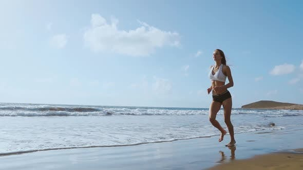Cover Image for Healthy Woman Running on the Beach, Girl Doing Sport Outdoor, Happy Female Exercising, Freedom