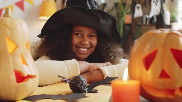Thumbnail for Portrait of Joyous Afro-American Girl in Witch Hat