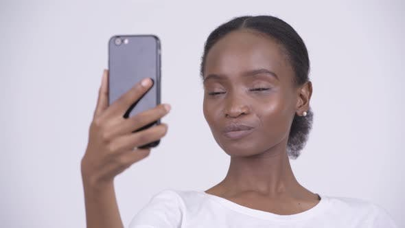 Thumbnail for Face of Happy Young Beautiful African Woman Using Phone