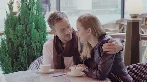 Romantic Couple Drinking Coffee On Date At Street Cafe