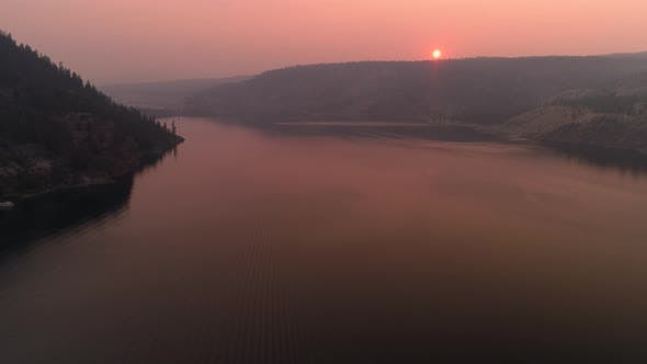 Thumbnail for Sunset Aerial Over Lake Roosevelt In Forest Fire Smoke Haze