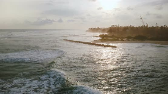 Thumbnail for Drone Flying Forward Along Incredible Exotic Tropical Sunrise Beach, Waves Reaching Coast Line and