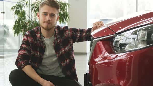 Thumbnail for Happy Handsome Man Posing with His New Auto Showing Car Keys To the Camera