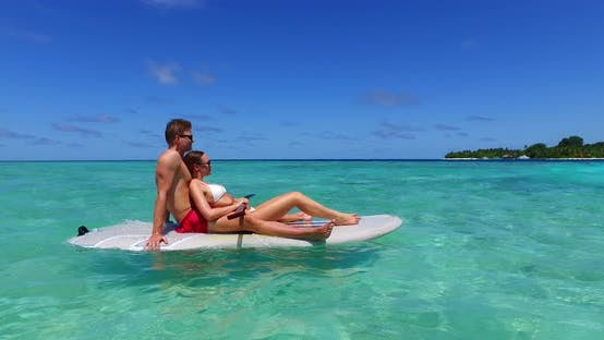 Thumbnail for Fun lady and man in love dating on vacation enjoy luxury on beach on sunny white sandy background