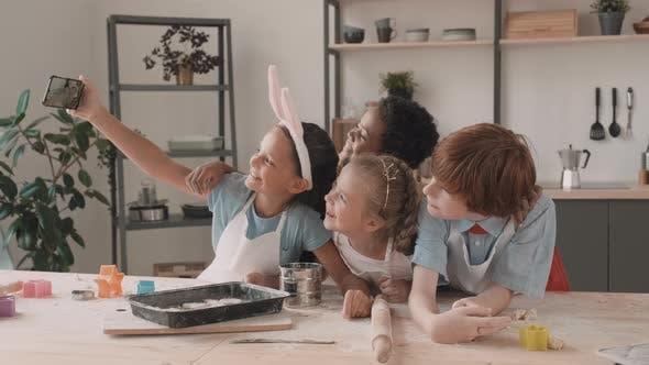 Thumbnail for Children Taking Selfie in Kitchen