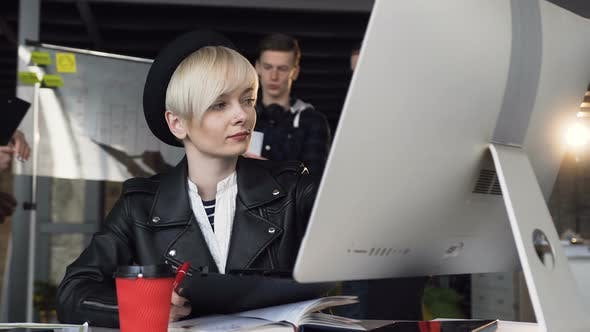 Thumbnail for Busy Young Business Woman Working at Modern Office Using Computer Touch Screen, Looking at Monitor.