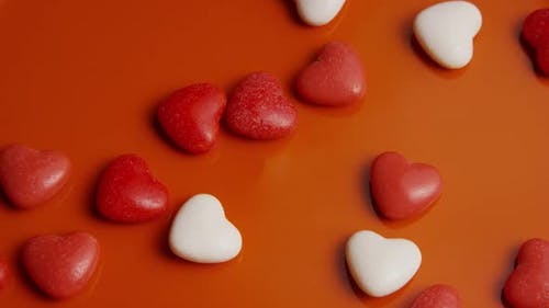Rotating stock footage shot of Valentines decorations and candies - VALENTINES 0045