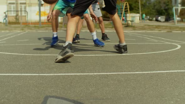 Thumbnail for Young Man on Basketball Court Dribbling with Ball