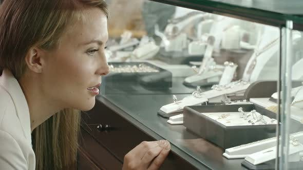 Thumbnail for Woman Looking at Beautiful Jewelry Collection in Shop Display