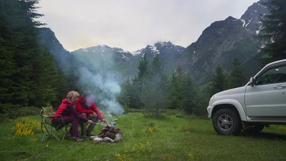 Thumbnail for Couple Chatting By Bonfire in a Camping in a Dark Mountain Valley