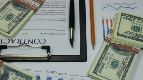 Business Contract And Money On The Table In The Modern Office Of The Company