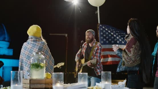 Thumbnail for Male Singer in a Plaid Shirt with His Bassist