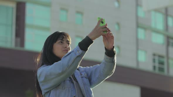 Thumbnail for Cheerful Teen Girl Taking Selfie with Smartphone