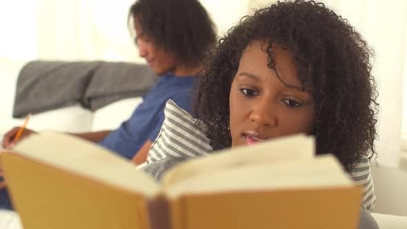 Thumbnail for Black teen couple doing homework