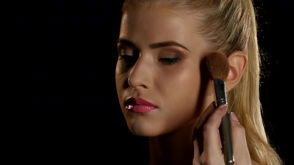 Thumbnail for Makeup Artist Putting Blush on Her Face with Brush, Black, Closeup