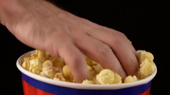 Thumbnail for Hands Grabbing Popcorn on Black, Slow Motion