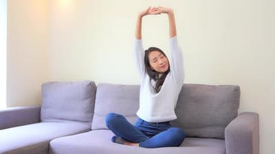 Asian woman sit on sofa and relax