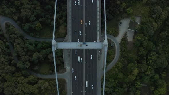Cars on Bridge Surrounded By Trees, Incredible Birds Eye Aerial View Forward
