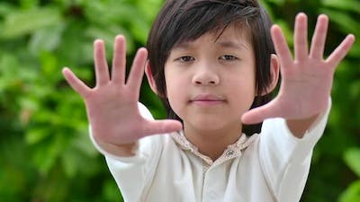Asian Child Show Stop Hands Gesture For Stop