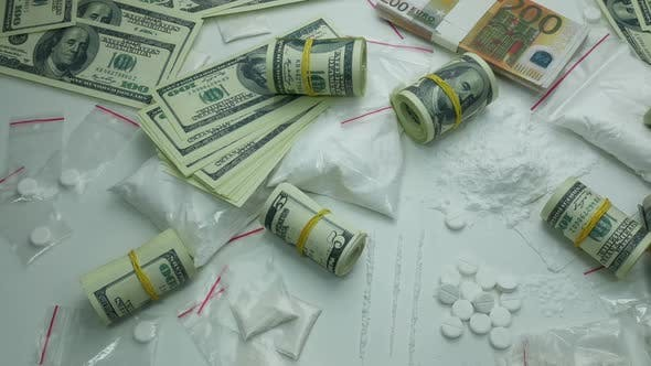 Thumbnail for Illegal Financial Profit Of The Drug Cartel From The Sale Of Cocaine And Narcotic Tablets
