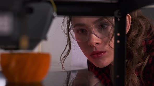 Designer Student Using a 3D Printer in College