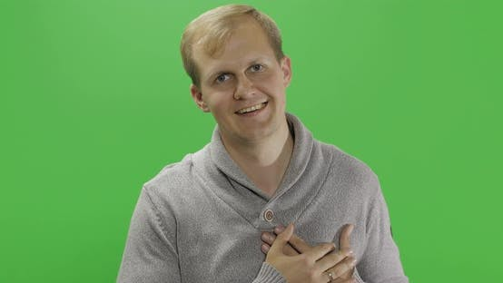 Thumbnail for Handsome Young Man in Gray Sweater Doing Love Gesture. Chroma Key
