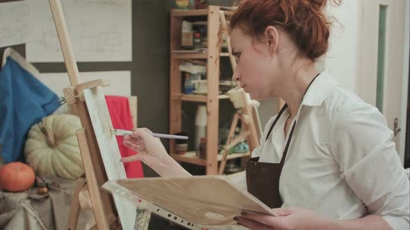 Thumbnail for Young Woman in Apron Painting with Oil on White Canvas