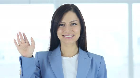 Thumbnail for Hello, Positive Young Businesswoman Waving Hand