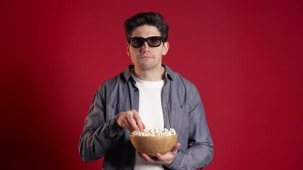 Cover Image for Young Man in 3d Glasses Watching Fascinating Comedy or Horror Movie
