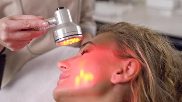 Thumbnail for Woman which Rejuvanating Her Face Using Ultrasonic Tool which Holding Professional Beautician
