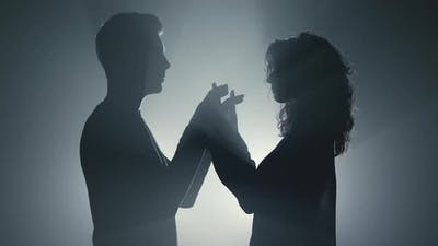 Sensual Couple Silhouette Holding Hands Indoors