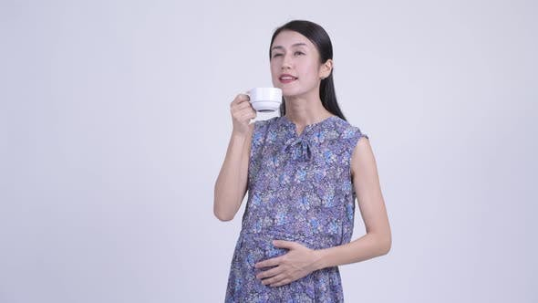 Thumbnail for Happy Pregnant Asian Woman Drinking Coffee