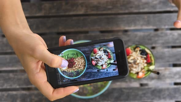 Thumbnail for Female Hands Taking Pictures Of Vegan Food With Smartphone In Healthy Cafe