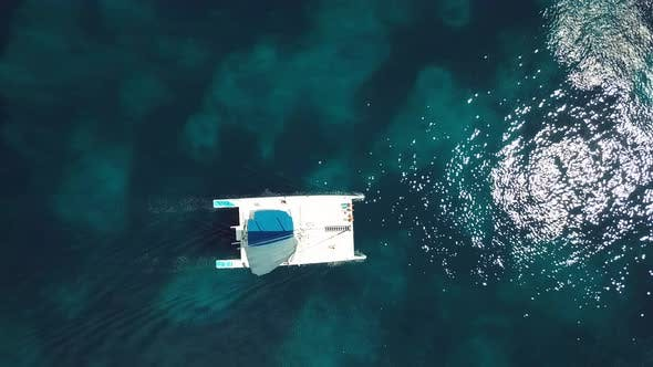 4k 24fps Cenital Drone Shoot Of The Catamaran In The Blue Water In The Caribbean In Sunny Day
