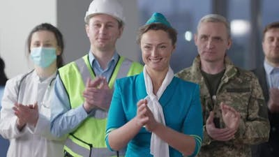 Group of People of Different Professions Clapping and Smiling Looking Away