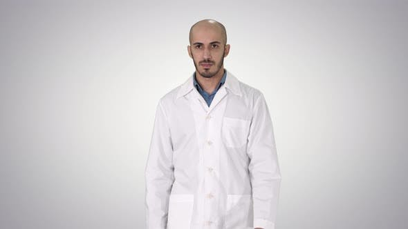 Thumbnail for Walking Male Arab Doctor on Gradient Background.