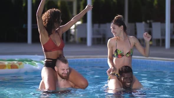 Happy Diverse Friends Having Fun in Swimming Pool