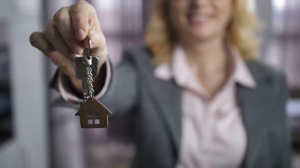 Thumbnail for Woman in Formalwear Showing Keys To Camera