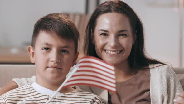 Thumbnail for Patriotic Mother and Son Waving American Flags