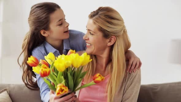 Thumbnail for Happy Daughter Giving Flowers To Mother at Home