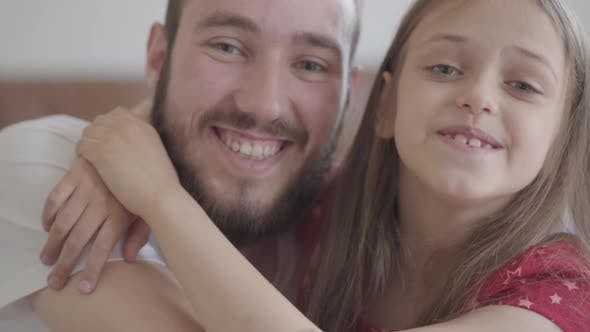 Thumbnail for Close Up Portrait Handsome Bearded Man and Cute Positive Girl Looking in the Camera Smiling, the