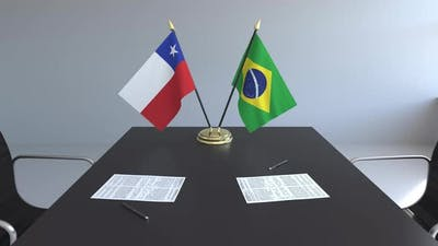 Flags of Chile and Brazil on the Table