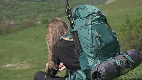 Thumbnail for Backpacker sitting on grass
